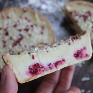 Gluten-free white chocolate, raspberry and cardamom tart